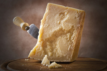 Parmesan cheese cutting on the chopping board