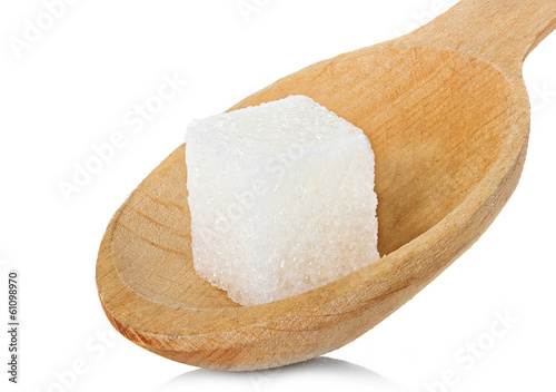 sugar cube in spoon