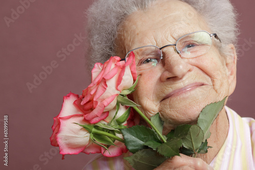Senior woman with roses