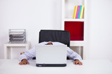 Businessman sleeping over the laptop