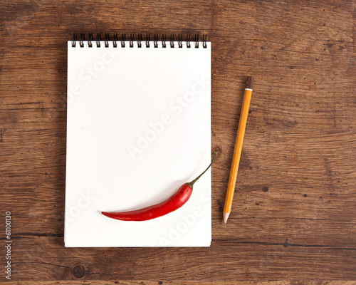 Blank notepad for recipes with pepper for your grocery list