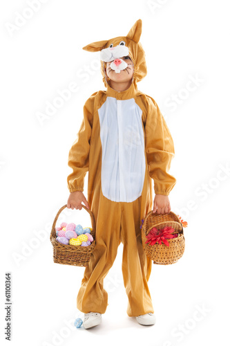 Child as easter hare with eggs and flowers