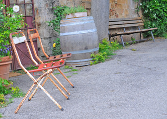 streetview with vintage seats in pienza; tuscany
