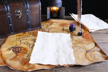 Work desk with parchment and old map.