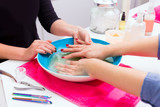 Nail saloon scrub bath exfoliant hands in bowl water poster