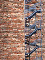 Fire escape on old brick wall
