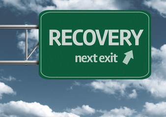 Recovery, next exit creative road sign and clouds
