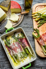 Asparagus wrapped in Parma ham with cheese