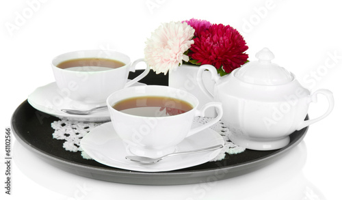 Cups of tea on tray isolated on white