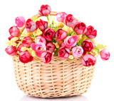 Bouquet of beautiful artificial flowers in wicker basket,