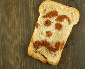 Funny toasts, on wooden background