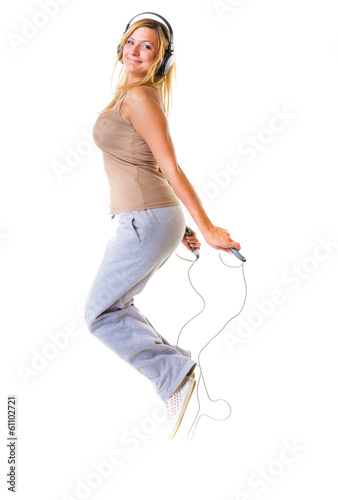 Sport girl with headphoes doing exercise with skip jump rope
