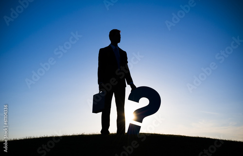 silhouette of Businessman Holding Question Mark