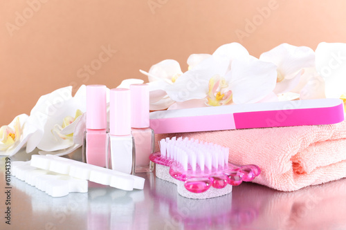 Pedicure set on table on beige background