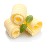 Fototapety Curls of fresh butter with basil, isolated on white