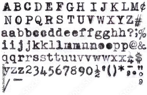 Leinwanddruck Bild American Typewriter aplphabet on white