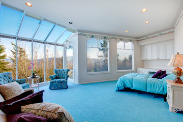 Amazing light blue and white bedroom with glass wall