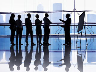 Silhouetted group of business people