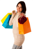 Attractive asian caucasian woman with shopping bags and credit c