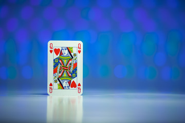 Red heart queen playing card with blue background