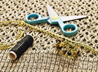 Closeup scissors, threads and beads