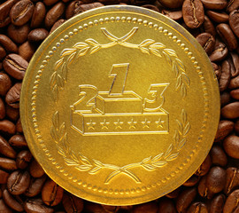 Coffee beans with chocolate medal