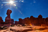 Light Flare Sun Sandstone Hoodoos Arches National Park Moab Utah