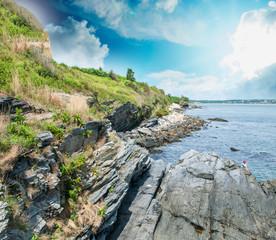 Rocks and vegetation over the ocean
