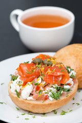 sandwich with salad of cottage cheese, tomato and salmon and tea