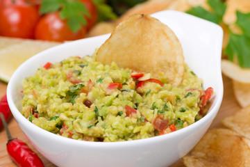 snack - Mexican sauce guacamole, close-up, selective focus