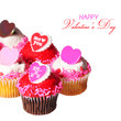 Cupcakes with Valentine hearts on the tops, isolated on white