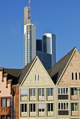 Frankfurt's historic buildings contrasting with a skyscraper.
