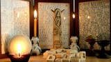 ancient runic altar: burning candles, Odin