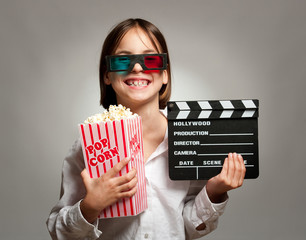 little girl wearing 3D glasses