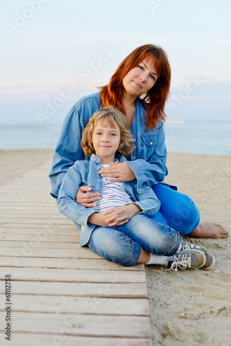 mother and daughter resting near the sea
