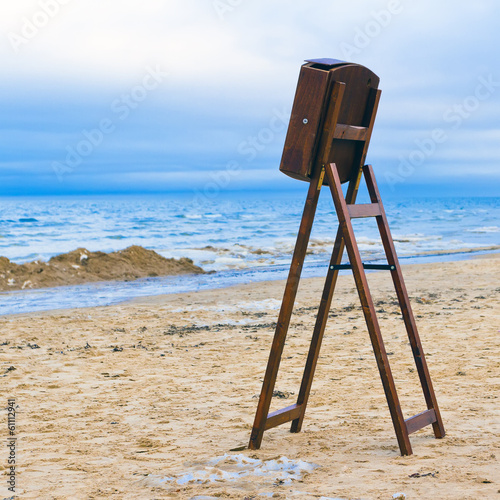 Vintage wooden menu board in front of winter beach