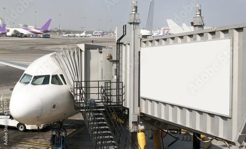 Leinwandbild Motiv Blank billboard on the gangway in the airplane