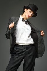 Woman feels like a man concept. Woman wearing top hat