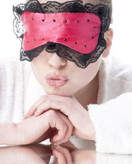 Woman with sleep mask - isolated on white.