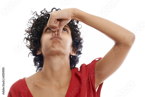 hispanic young woman holding breath
