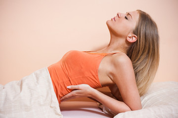 Young woman having pain in back