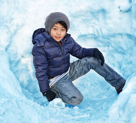 Cool Asian boy playing in snow