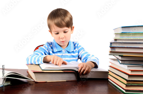 boy reading a big book