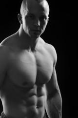 Body builder champion posing in studio