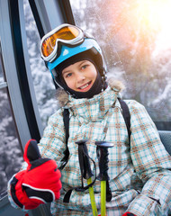 Skier girl on ski lift