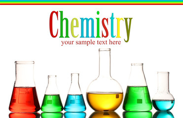 Different laboratory glassware with color liquid and with