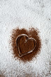 Chocolate heart on icing sugar