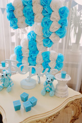 festive decoration in blue and white colors of paper flowers, ca