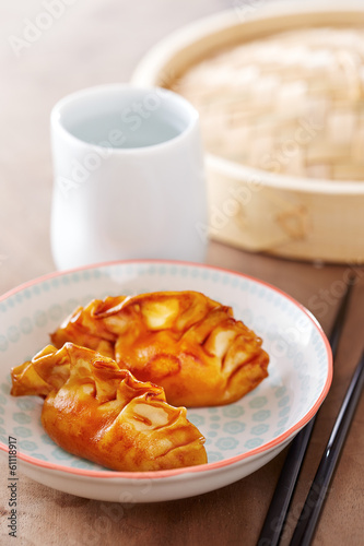Cooked dim sums with soy sauce