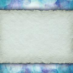 Handmade paper sheet on patterned background